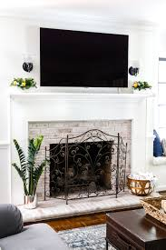 diy lime washed brick fireplace bless