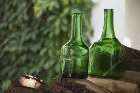 antique bottles of green glass stock