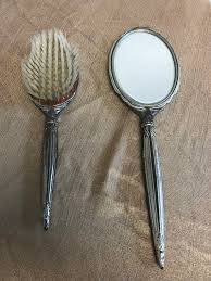 vintage handheld mirror and brush set