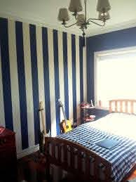 How To Paint Striped Wall Decals In 2020 Blue Room Decor Blue Bedroom Decor Navy Blue Bedrooms