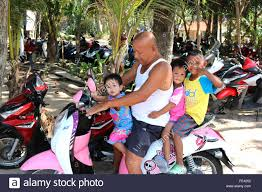 Thailand Phuket General Taking the kids for a ride Adrian Baker Stock  Photo: 94746402 - Alamy