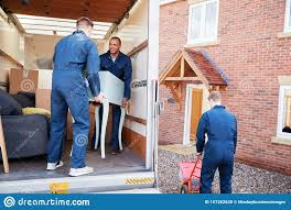 Removal Company Workers Unloading Furniture And Boxes From Truck Into New  Home On Moving Day Stock Photo - Image of property, people: 157262628
