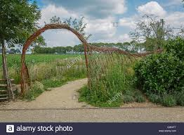 Arch And Tracery Fence Woven From Willow Twigs Stock Photo Alamy