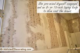 49 thin drywall over wallpaper on