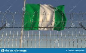 Defocused Waving Flag Of Nigeria Behind Barbed Wire Fence 3d Rendering Stock Illustration Illustration Of National Restricted 140225265