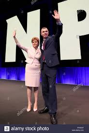 First Minister Nicola Sturgeon welcomes Plaid Cymru party leader Adam Price  during day two of the SNP autumn conference at the SEC, Glasgow Stock Photo  - Alamy