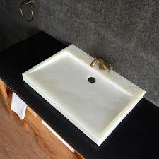 a bathroom sink crossword clue image