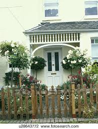 edwardian cottage painted white with