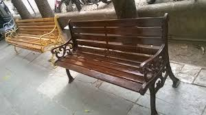 cast iron bench with wooden strips