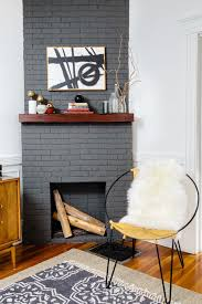 dark gray painted brick fireplace