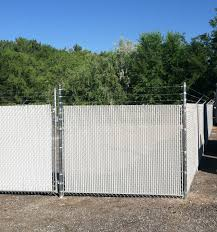 3 Strand Barbed Wire Chain Link Fence With White Privacy Slats Installed By Frontier Fence Company And Trea Fencing Companies Fence Contractor Chain Link Fence