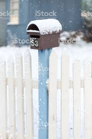 Snow Covered Picket Fence And Mailbox Stock Photo Download Image Now Istock