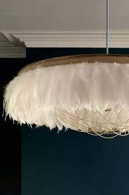 feather light shade featuring chains