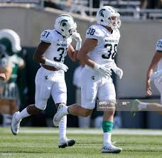 Cornerback T.J. Harrell of the Michigan State Spartans and linebacker...  News Photo - Getty Images