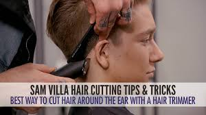 ears with a hair trimmer