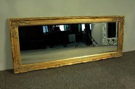 large baroque mirror covered with gold