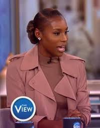 Issa Rae. Low parted side bun with flat ...