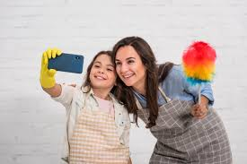 Mother and daughter taking a selfie with cleaning objects | Free Photo