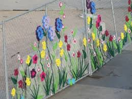 Crocheted Flowers On Chainlink Union Station In Denver Photo From Project Stash Blog Fence Decor Fence Art Yarn Bombing