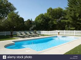 Pools Overall Pool And Surrounding Area White Picket Fence 5 Chaise Stock Photo Alamy