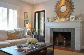 starburst mirror above fireplace