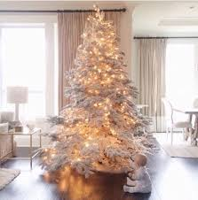 Depending on how you decorate it, the white Christmas tree can be ...