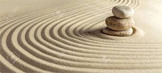 japanese zen garden with stone in raked