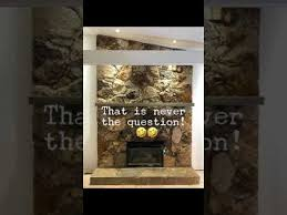 rock fireplace makeover with chalk