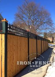 A Custom 2ft Tall Iron Fence Panel Used As An Accent Piece On Top Of A Beautiful And Hefty Wood Fence Backyard Fences Fence Landscaping Iron Fence Panels