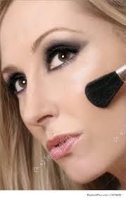 woman face and makeup brush stock photo