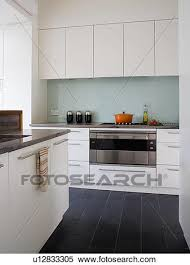 floor tiles in modern white kitchen