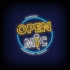 Open mic neon signboard on brick wall | Premium Vector