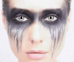 young woman with makeup demon punk