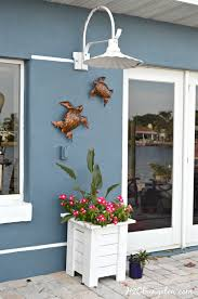 hang outdoor wall decor without nails