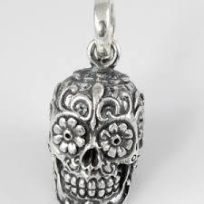 winged skull with garnet eyes pendant