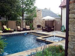 rectangular pool hot tub and fireplace