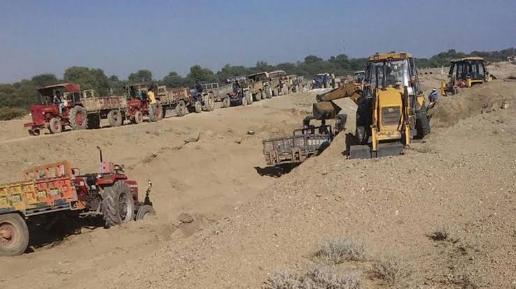 Image result for Sand mine workers keep up rally against illegal sand mafia""