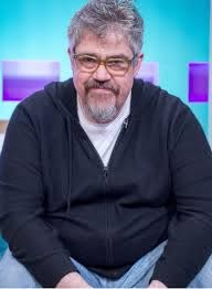 Who is Phill Jupitus, when did he appear alongside Sean Hughes on Never  Mind The Buzzcocks and who's his wife?