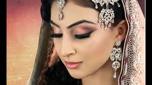 subtle peach asian bridal makeup you