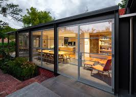 steel and glass conservatory to house