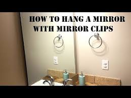 how to hang a mirror with mirror clips