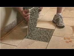 repair gaps between floor tiles