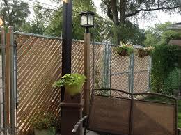 Adding Privacy To A Chain Link Fence With Cedar Lath Outdoor Gardens Garden Inspiration Easy Garden