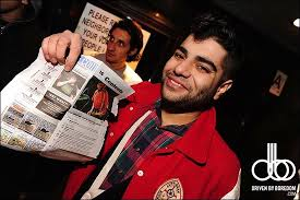 This is a Photo of Das Racist's Himanshu Suri Holding a Photo of Himself in  the Village Voice | The Village Voice