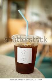 cold coffee on minimal table slogan stock photo edit now