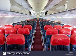 PATTAYA, THAILAND - FEBRUARY 26, 2016: inside Thai AirAsia A320. Thai  AirAsia is a joint venture of Malaysian low-fare airline AirAsia and  Thailand's Stock Photo - Alamy