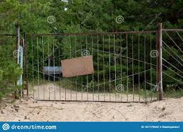 Brown Empty Cardboard Sign On An Iron Fence Close Up Among The Forest And Sand Stock Photo Image Of Walking Signpost 167179042