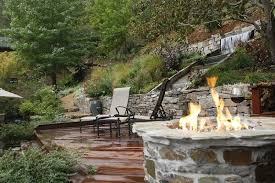 diy fire pit with waterfall pool with