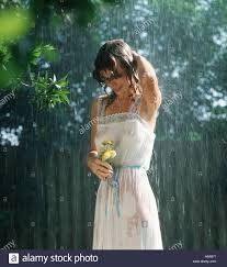 attractive wet girl holding flowers in the rain Stock Photo ...
