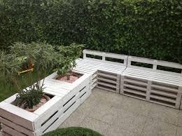 pallet sofa planter in the garden